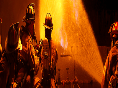 Firefighter with handheld nozzle