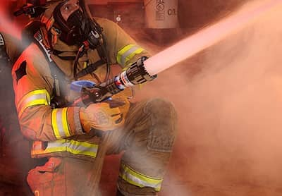 Firefighter using a Mid-Force nozzle