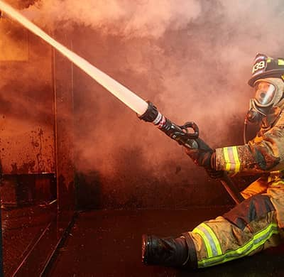 Firefighter using a Midmatic nozzle