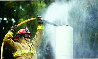 image of firefighter using chimney snuffer