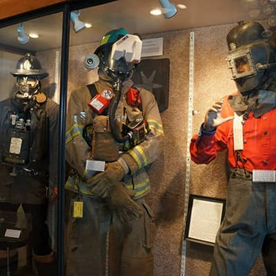 mannequins with PPE through the years
