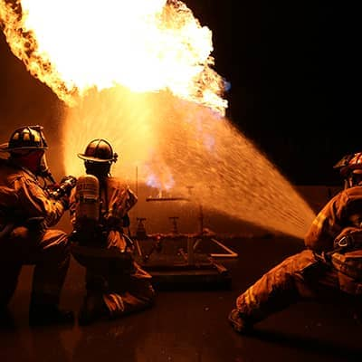 Firefighters fighting a propane fire